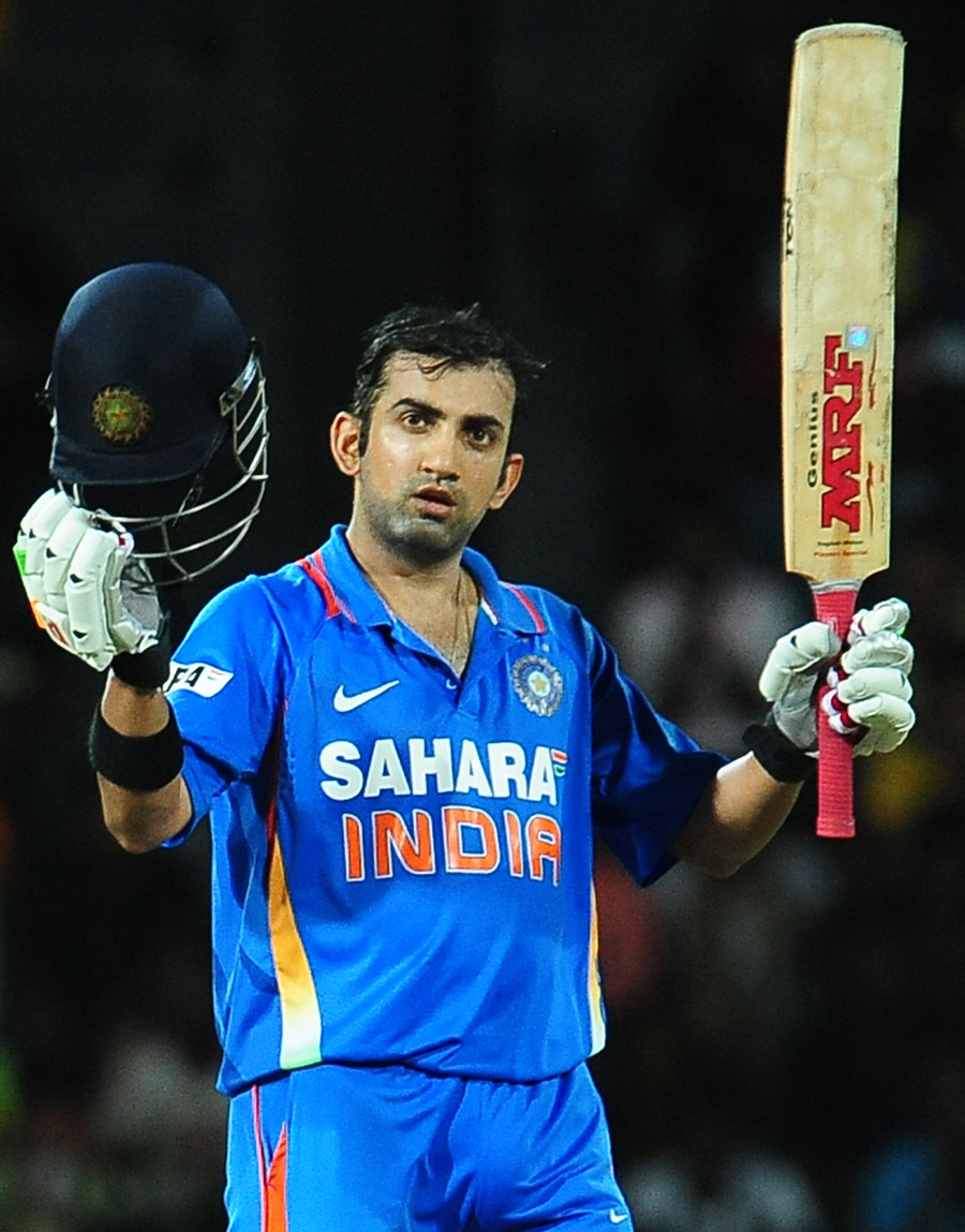 Indian cricketer Gautam Gambhir raises h